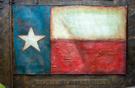 Flag of Texas on memorial plate with the date of 1836, when Texas declared idependence from Mexico