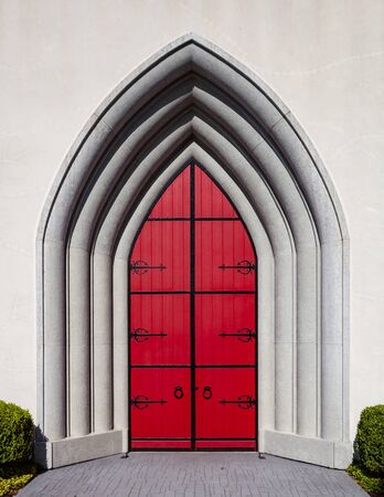Gothic style door, painted bright red, front view
