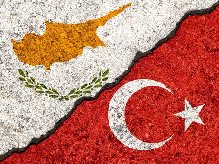 Flags of Turjey and Cyprus painted on cracked wall background/Turkey versus Cyprus conflict concept 版權商用圖片