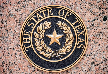AUSTIN, TEXAS - JULY 2, 2019 - The official seal of The State of Texas mounted on granite wall