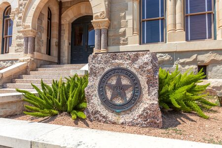 VICTORIA, TEXAS - JUNE 9, 2019 - Historic Victoria County Courthouse entrance, built in 1823 with old Texas Highway Department logo