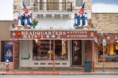 FREDERICKSBURG, TEXAS - MAY 30, 2019 - Headquarters Hats Storefront, a small boutique that carries the famous Stetson Hats and Lucchese Boots brands. Western American fashion