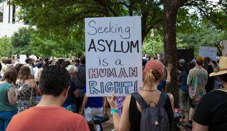 AUSTIN, TEXAS - JULY 2, 2019 - People protesting against President Donald Trump and border camps. Different demands written on pancards.