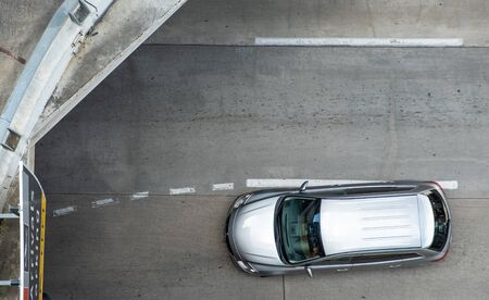 Aerial view of silver car in airport with copy space. Top view of vehicle on street 版權商用圖片