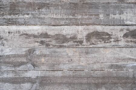Concrete wall texture with wooden pattern. Cement background with lines and air bubbles