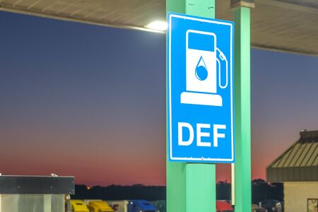 Diesel exhaust fluid or DEF sign posted in a truck stop, next to fuel pump 版權商用圖片