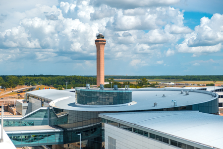 HOUSTON, TEXAS - AUGUST 22, 2019 - IAH George Bush Intercontinental International Airport with the view of control tower on a sunny summer day