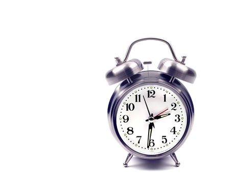 An alarm clock isolated against a white background.