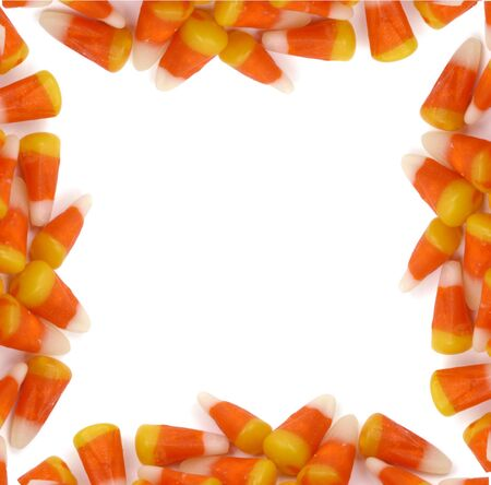 A  border frame made of up candy corn Foto de archivo