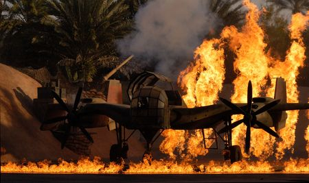 An old biplane caught on fire after an explosion.