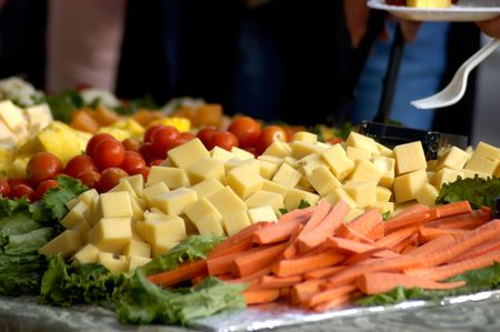 A cheese and vegetable tray. Foto de archivo