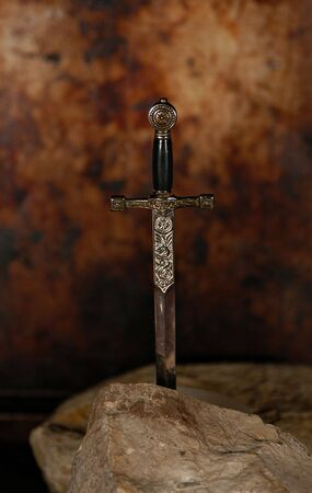 stuck: A sword stuck firmly in a stone.