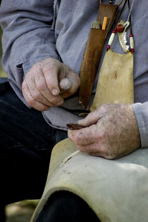 arrowheads: Close-up detail of a man making flint arrowheads by hand. Stock Photo