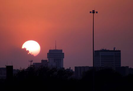 A sunset in Wichita, Kansas but could also represent most downtown city areas.