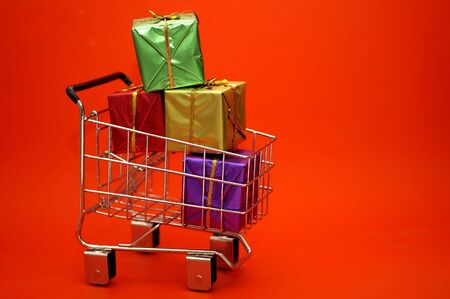 Wrapped presents in a shopping cart. Can be used for Christmas or other occasions. Stock Photo - 713874