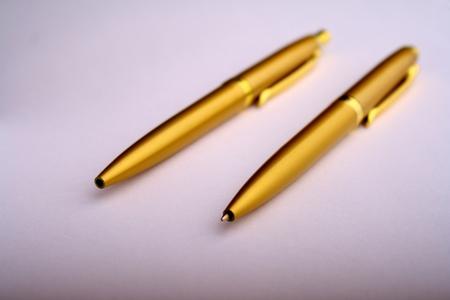 A couple of golden pens photo
