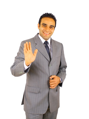 Smiling young businessman saying  goodbye to you -  isolated on white photo