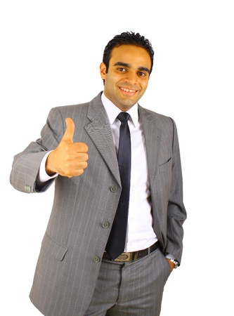 Portrait of young business man with  thumbs up - isolated on white photo