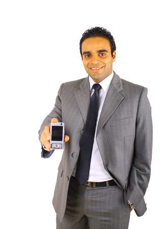 Smiling young businessman with mobile phone -  isolated on white photo