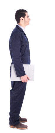 Young worker, side view - isolated on white