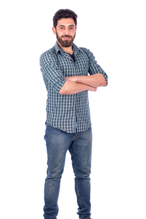 Portait of confident beard young man wearing green shirt and jeans, isolated on white background