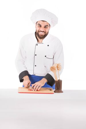 Happy beard chef smiling and preparing food, guy wearing a chef uniform and chef hat, isolated on white background Banco de Imagens