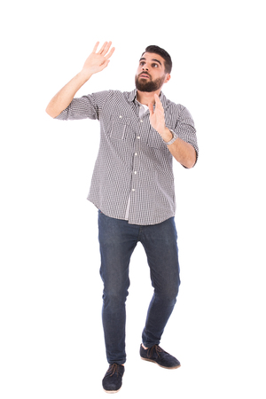 Handsome beard man feeling scared, guy wearing gray shirt and jeans, isolated on white background Banco de Imagens