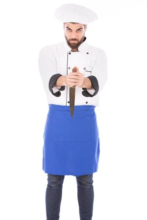 Happy beard chef looking to you and holding a knife, guy wearing a chef uniform and chef hat, isolated on white background