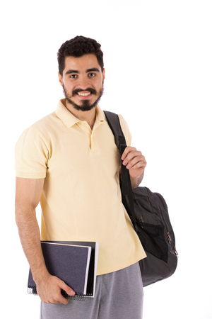 Handsome happy beard young man holding notebooks and backbag, guy wearing beige t-shirt, isolated on white background