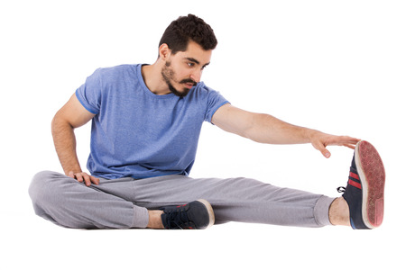 Handsome happy beard young man making exercise, guy wearing blue t-shirt, isolated on white background