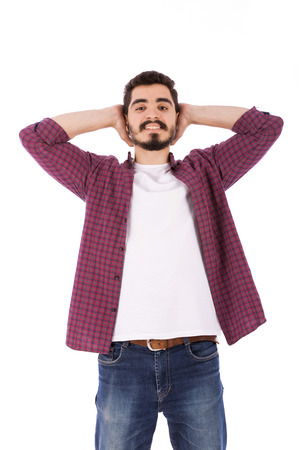 Handsome happy beard young man smiling and holding his head, guy wearing red shirt and jeans, isolated on white background
