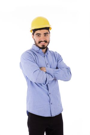 Happy beard engineer smiling and standing confidently, guy wearing blue shirt and yellow helmet, isolated on white background
