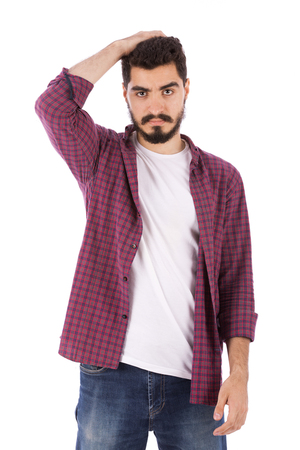 Handsome beard young man holding his head, guy wearing red shirt and jeans, isolated on white background
