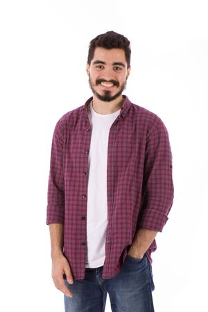 Handsome happy beard young man smiling and standing confidently, guy wearing red shirt and jeans, isolated on white background