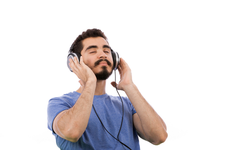 Handsome happy beard young man smiling and listening to music, guy wearing blue t-shirt, isolated on white background