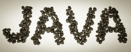 The word JAVA spelled in coffee beans; panoramic crop; sepia colortone
