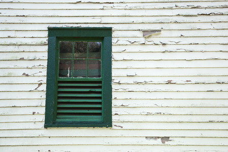 Architectural Details show peeling paint and an old window