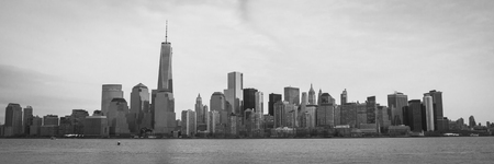 world trade center: A black and white image of the Lower Manhattan Skyline with the World Trade Center Freedom Tower; panoramic format Stock Photo