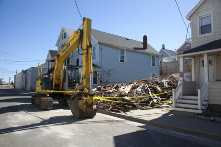 rebuild: A lot of debris where a house used to stand in Sea Bright, New Jersey.  Photo taken October 15, 2013, almost one year after Hurricane Sandy hit the eastern coast of the United States. Editorial