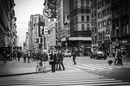 A city street view shot in the Flatiron District in Manhattan, New York City; black and white colortone
