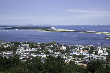 A view from the Twin Lights in the Atlantic Highlands, overlooking the Highlands and Sandy Hook, New Jersey; in the distance, you can see New York City; Look closely and you can see the crowded beaches of this popular Jersey Shore location  Photo taken in
