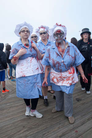 Photos of Zombies walking on the boardwalk and through the streets of Asbury Park, New Jersey during the 2013 Asbury Park Zombie Walk.  This year they took back the Guinness Book of World Records record for the largest gathering of zombies! Here are the l