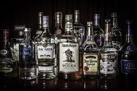 A selection of different bottles of liquors neatly arranged  Editorial Use Only