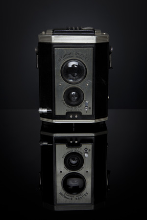 kodak: A Kodak Brownie Reflex Synchro Model sits on a reflective black surface; this camera was marketed from 1940-1946 and took 127 film; it retailed for  6 US dollars Editorial