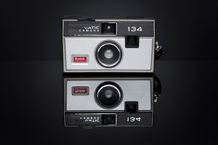 kodak: A Kodak Instamatic 134 camera sits on a black reflective surface  This camera was marketed from 1968-1971, took 126 film, and retailed for  25 50 US dollars