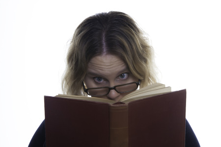 A woman is ready a book, looking at it deep in thought photo