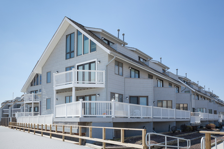 townhomes: POINT PLEASANT, NJ - APRIL 5:  Clean lines and seaside architecture are seen on townhouses along the boardwalk.  Photo taken April 5, 2014 Editorial