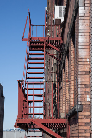 Fire escapes on the exterior of an apartment building in New York City. photo