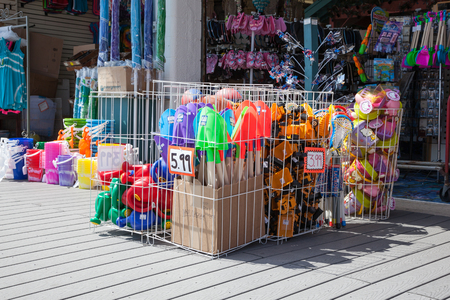 Buckets, shovels, and other beach toys sit in bins outside a boardwalk store in Point Pleasant, New Jersey, USA; photo taken on April 5, 2014; editorial use only