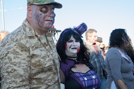walking corpse: ASBURY PARK, NJ - October 3, 2014:  Zombies wander the Asbury Park Boardwalk during the 2014 New Jersey Zombie Walk. Editorial